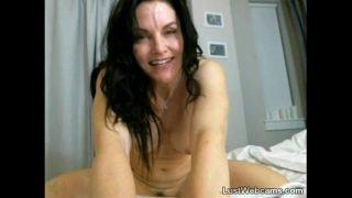 Busty mature rides dildo on webcam