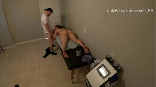 Cheating wife gets fucked in the massage table while husband waits outside