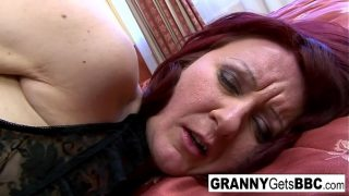 Mature red head takes a big black cock deep in her ass